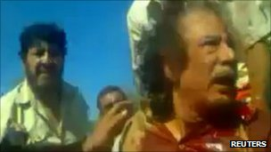 Image of Gaddafi's capture taken from amateur video, 21 October 2011.