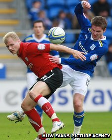 Gunnarsson battles for the ball with Barnsley's Jay McEveley
