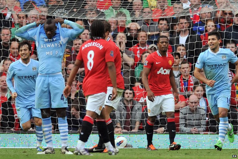 Mario Balotelli (second left) scores for Manchester City