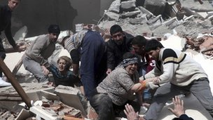 People are helped from the rubble of collapsed buildings in a village near the city of Van, Turkey - 23 October 2011