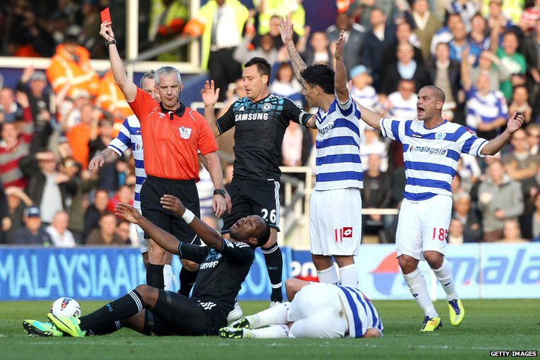 Didier Drogba (on the ground) is sent off
