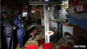 Police inspect the scene of an explosion inside a club in Kenya's capital Nairobi on 24 October 2011