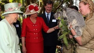 Queensland Premier Anna Bligh shows the Queen a pair of koalas