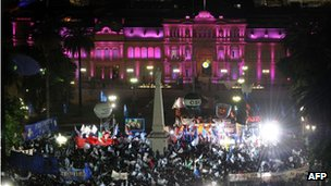 Supporters in the Plaza de Mayo with the presidential place, the Casa Rosada or Pink House,   in the background