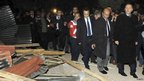 Turkey's Prime Minister Tayyip Erdogan (right) visits Ercis after the earthquake