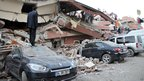 A collapsed building in the city of Van, Turkey - 23 October 2011