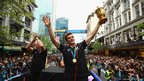 Richie McCaw, the All Black captain, shows the World Cup to the gathered crowds in Auckland