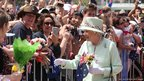 Queen Elizabeth II greets the crowd along the Brisbane River on 24 October 2011 in Brisbane, Australia