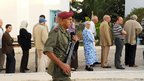 Soldier patrols outside queue of voters in Tunis (23 Oct 2011)