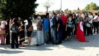 People wait in line outside a pollling station in the coastal resort of Hammam Sousse, a former stronghold of ousted President Zine el Abidine Ben Ali (23 Oct 2011)