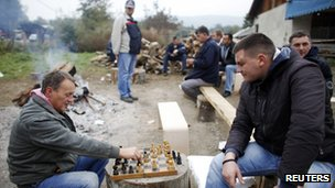 Kosovo Serbs play chess at the barricades in the village of Zupce
