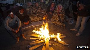 Earthquake survivors in Ercis, Turkey, by fire - 24 October 2011