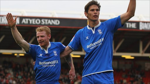Chris Burke (left) celebrates his goal with Nikola Zigic