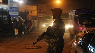 Kenyan police secure the scene of an explosion in the Kenyan capital Nairobi 24 October 2011