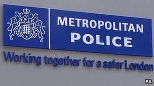 A sign showing the logo of the Metropolitan Police
