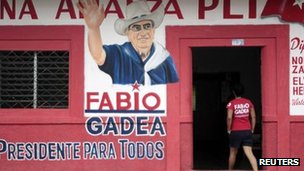 A supporter of Fabio Gadea, presidential candidate for the Liberal Independent Party (PLI), enters a campaigning house in Diriomo town 28 September 2011