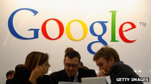 Visitors below a Google banner at the Frankfurt Book Fair 