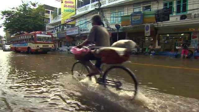 A cyclist on a flooded Bangkok street