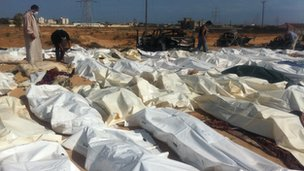 Dead bodies lie on the ground in bags in Sirte, Libya