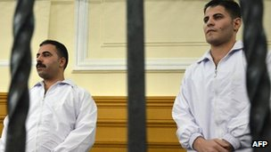 Egyptian undercover police officers Awad Ismail Suleiman (R) and Mahmud Salah Amin, convicted of killing Khaled Said last year, in Alexandria court - 24 September 2011
