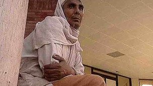 Roshan Khan Rindh waiting at the hospital for news of his son