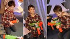 A boy plays with a Nerf Vortex Nitron Blaster