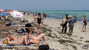 Tourists on a beach near Djerba