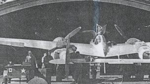 A Lockheed P38 Lightning in a blister hanger at Stoneycross