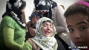 Relatives of earthquake victims mourn