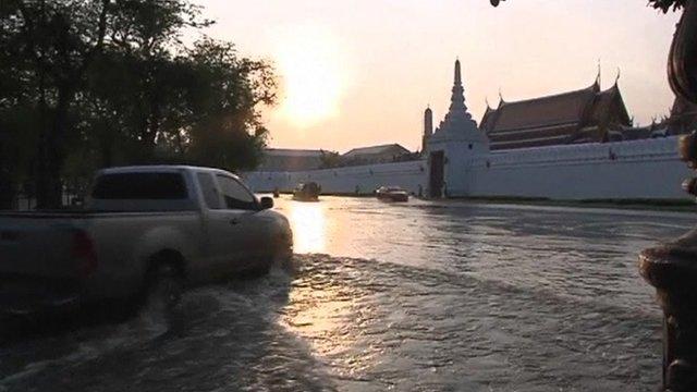 Car driving through flood water