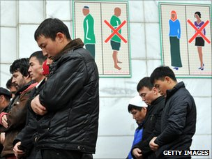 Kazakh Muslims pray outside a mosque in Almaty
