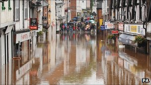 Flooded shops are viewed in Droitwich, Worcestershire. July 2007