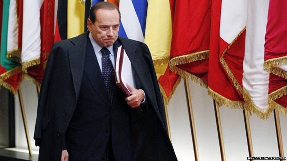 Italy's Prime Minister Silvio Berlusconi leaves a euro zone leaders summit in Brussels