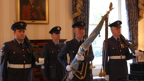 201 Squadron standard accompanied by former members of the squadron at Guernsey's Government House