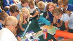 Students from Bookwell Primary School explore their 'culture box' sent to them by Grund-und Realschule Fockbeck