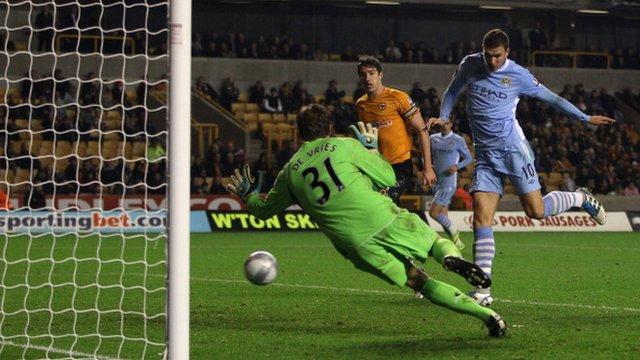 Edin Dzeko scores Manchester City's fifth goal