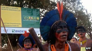 Caiapo indigenous men demonstrating on the road leading to the construction site of the Belo Monte hydroelectric dam
