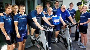 Staff at Hawksford cycling on exercise bikes