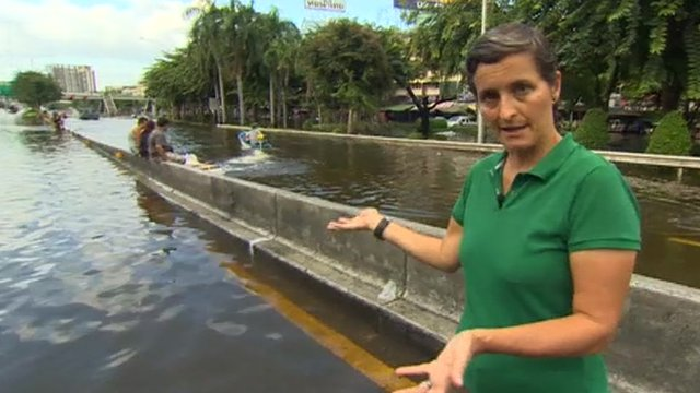 Rachel Harvey on flooded street