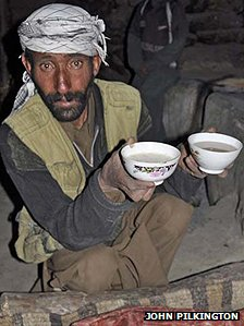 A man holding two cups of yak's-milk yogurt