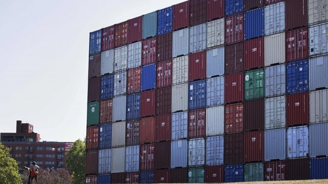 &quot;IOU&quot; written out in an enormous stack of shipping containers