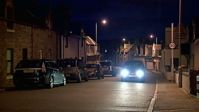 Cars on a street at night