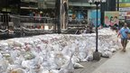Pile of sandbags on street. Photo: Lindsay McColl