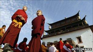 Young monkls stand outside Gandan Monastery, Ulaanbaatar