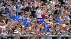 Hundreds of people lined the banks of Brisbane River to wave at the Queen as she sailed past.