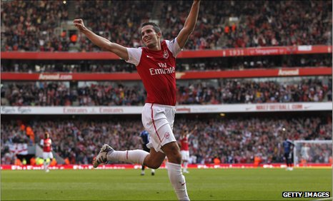 Robin van Persie celebrates his second goal