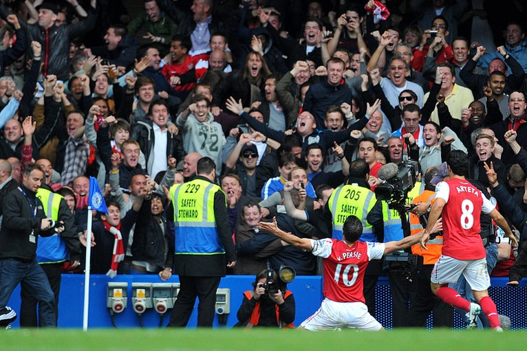 Arsenal's Robin van Persie celebrates scoring their fifth goal of the game to complete his hat-trick