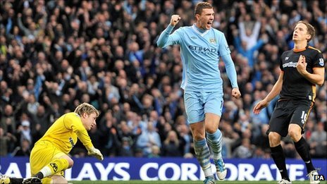 Wayne Hennessey and Edin Dzeko