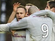 Motherwell's Tom Hateley is mobbed after scoring the winner