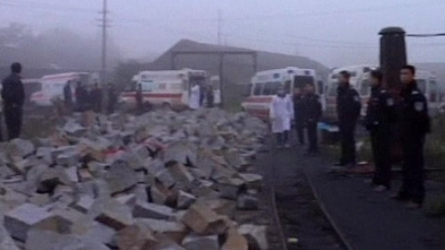 Emergency services at scene of explosion at coal mine in China